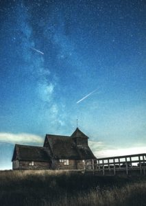 Shooting Stars in the Sky over house - space backgrounds