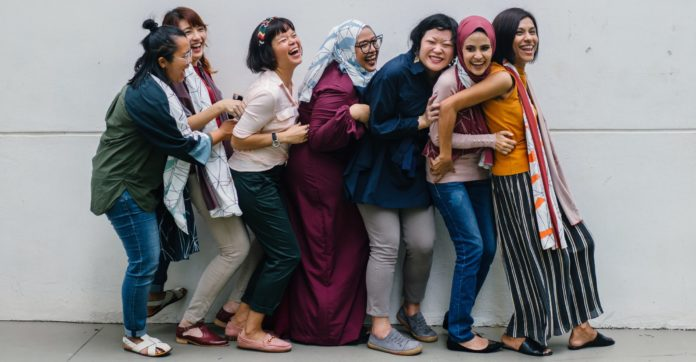 Lifestyle Photography - Group of Ethnic Women Laughing in Line